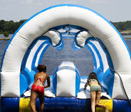 Children playing on waterslide. Picture of two young girls playing on a waterslide Royalty Free Stock Image