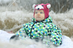 Children playing in winter field Royalty Free Stock Images