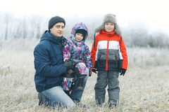 Children playing in winter field Royalty Free Stock Photography