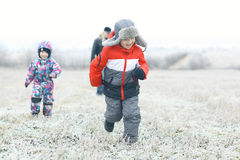 Children playing in winter field Royalty Free Stock Photo