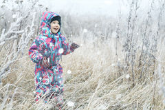 Children playing in  winter field Stock Photos