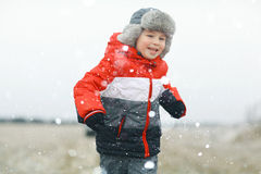 Children playing in winter field Stock Photography