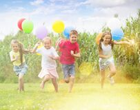 Free Children Playing With Colorful Balloons Royalty Free Stock Photos - 191971158