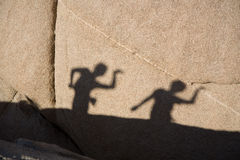 Children Playing With Their Shadow Royalty Free Stock Photo