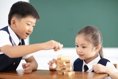 children playing wood blocks in classroom Stock Photography