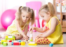 Children playing wooden toys at home Royalty Free Stock Image