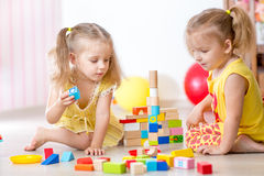 Children playing wooden toys at home Royalty Free Stock Images