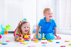 Children playing with wooden toys Stock Photography