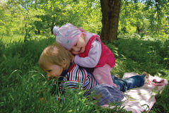 Children plays in green grass Stock Image