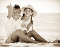 Children pointing with finger on sandy beach Royalty Free Stock Photo