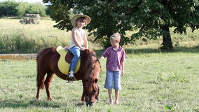 Children with pony horse stock footage