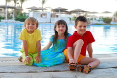 Children by the pool Royalty Free Stock Image