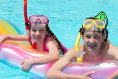 Children in Pool with Goggles Stock Images