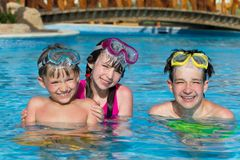 Children in pool on holiday Royalty Free Stock Photos
