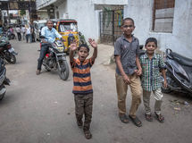 Children in poor city area in India stock photography