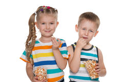 Children with popcorn Stock Image