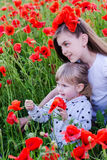 Children on poppy flower field Royalty Free Stock Photography