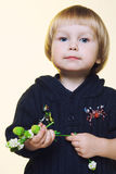 Children with porcelain flowers. In studio on light background Stock Image
