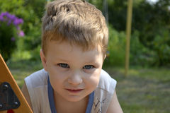 Children. Portrait of a little boy in the summer outdoors Stock Images