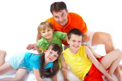 Children posing with adult Royalty Free Stock Photos