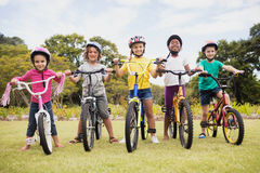 Children posing with bikes. In the park royalty free stock images