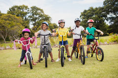 Children posing with bikes. In the park royalty free stock photo