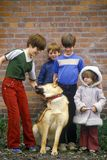 Children posing with dog, Harrison, ID Royalty Free Stock Photography