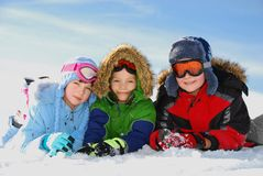 Children posing in snow gear Stock Images