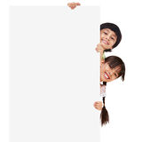 Children posing with a white board Stock Photos