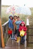 Children Posing With Umbrella Stock Image