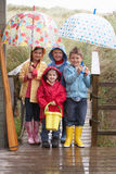 Children Posing With Umbrella Royalty Free Stock Images