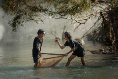 Rural children fishing at the river Royalty Free Stock Image
