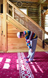 Children praying in the mosque Royalty Free Stock Images
