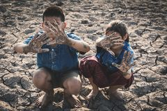 Children praying for the rain on lake. Concept drought and shortage of water crisis Royalty Free Stock Image