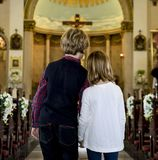 Children praying together inside a church Royalty Free Stock Photography