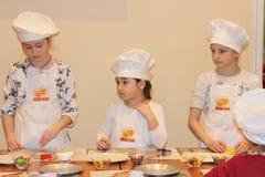 Children prepare Christmas cookies Stock Images