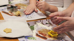 Children prepare Christmas cookies Royalty Free Stock Image