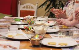 Children prepare Christmas cookies Stock Photos