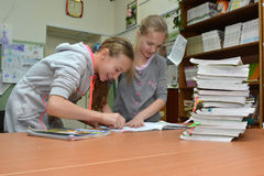 Children prepare for the delivery of books in the library Stock Photo
