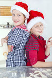 Children preparing christmas cake Royalty Free Stock Images