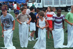Children preparing for gunny sack race Royalty Free Stock Photos