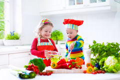 Children preparing healthy vegetable lunch Royalty Free Stock Photography