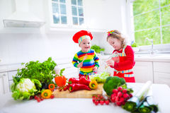 Children preparing healthy vegetable lunch Stock Photo