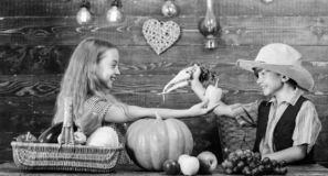 Children presenting farm harvest wooden background. Kids farmers girl boy vegetables harvest. Farming teaches kids where. Their food comes from. Siblings having royalty free stock photo