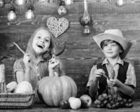 Children presenting farm harvest wooden background. Reasons why every child should experience farming. Farm market. Siblings having fun. Kids farmers girl boy stock image