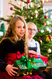 Children with presents and tree on Christmas eve Stock Image