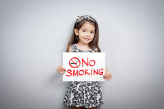 Children pretend holding a no smoking sign. Stock Photo