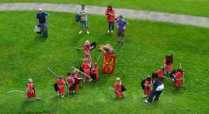 Children pretending to be Roman Soldiers. Chester, Cheshire, England - July 21, 2012: Children pretending to be Roman Soldiers being watched by adults at Chester Stock Photos