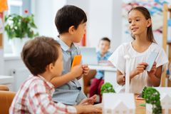 Pretty girl speaking with mates in a class. Children. Pretty nice girl speaking with mates while being in a class royalty free stock photo