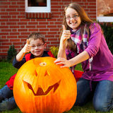 Children proud of their jack-o-lantern Stock Image